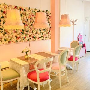 Pink tables with hanging latterns and flower background